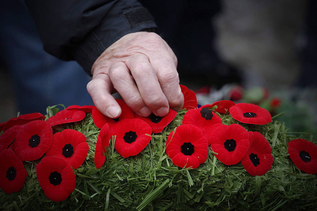 Poppies are placed on a wreath at a cenotaph during a Remembrance Day service in Winnipeg, Saturday, Nov. 11, 2017. Canadians will gather at cenotaphs and monuments across the country this morning to remember and honour those who took up arms ??? and in some cases paid the ultimate price ??? to defend this country and its way of life.THE CANADIAN PRESS/John Woods