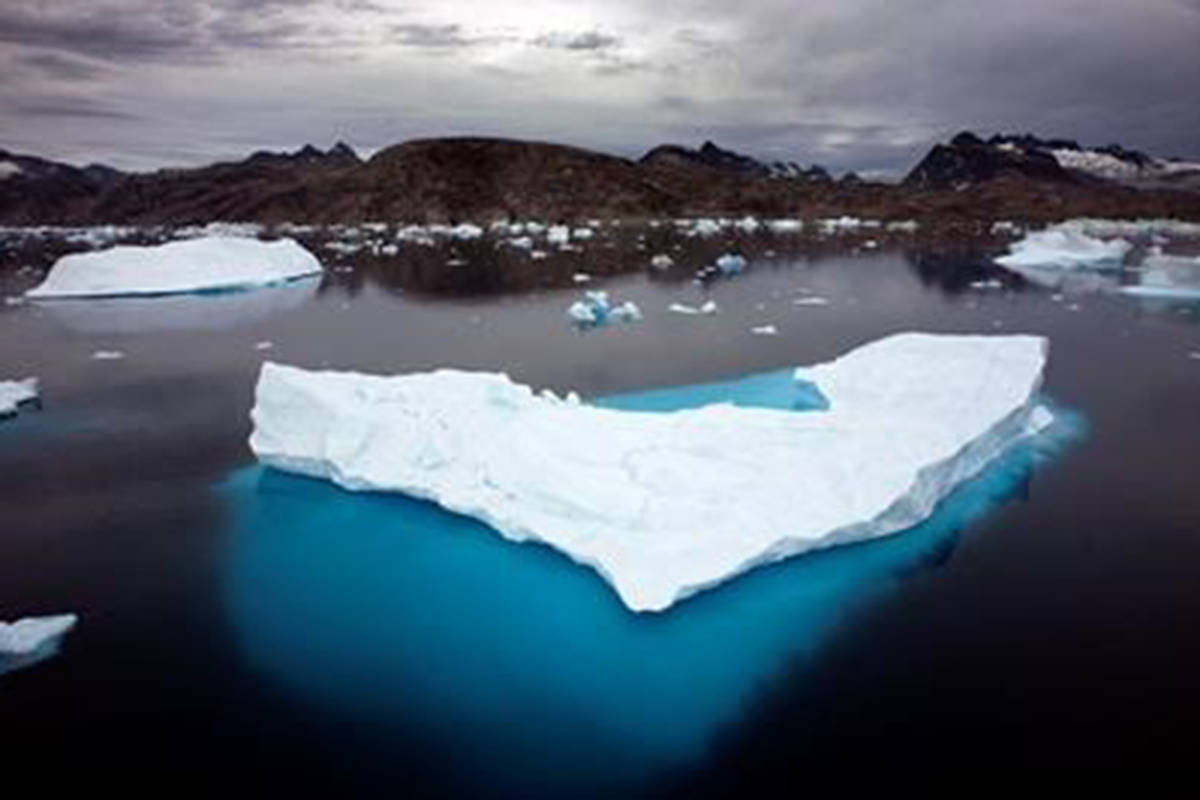 Icebergs float in a bay off Ammassalik Island, Greenland on July 19, 2007. A new report from the international medical journal The Lancet says a child born today will never know a life where their health isn't placed at risk by a warming planet. (John McConnico/AP)