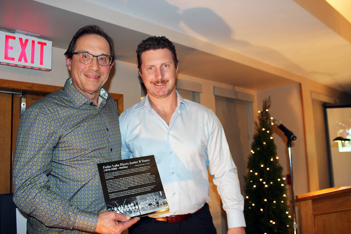 Mike Armstrong receives the North Cowichan/Duncan Sports Wall of Fame plaque on behalf of the Fuller Lake Junior B Flyers program from Mat Ellison, a previous Wall of Fame inductee and long-time professional player in Russia who also had a stint in the NHL. (Photo by Don Bodger)