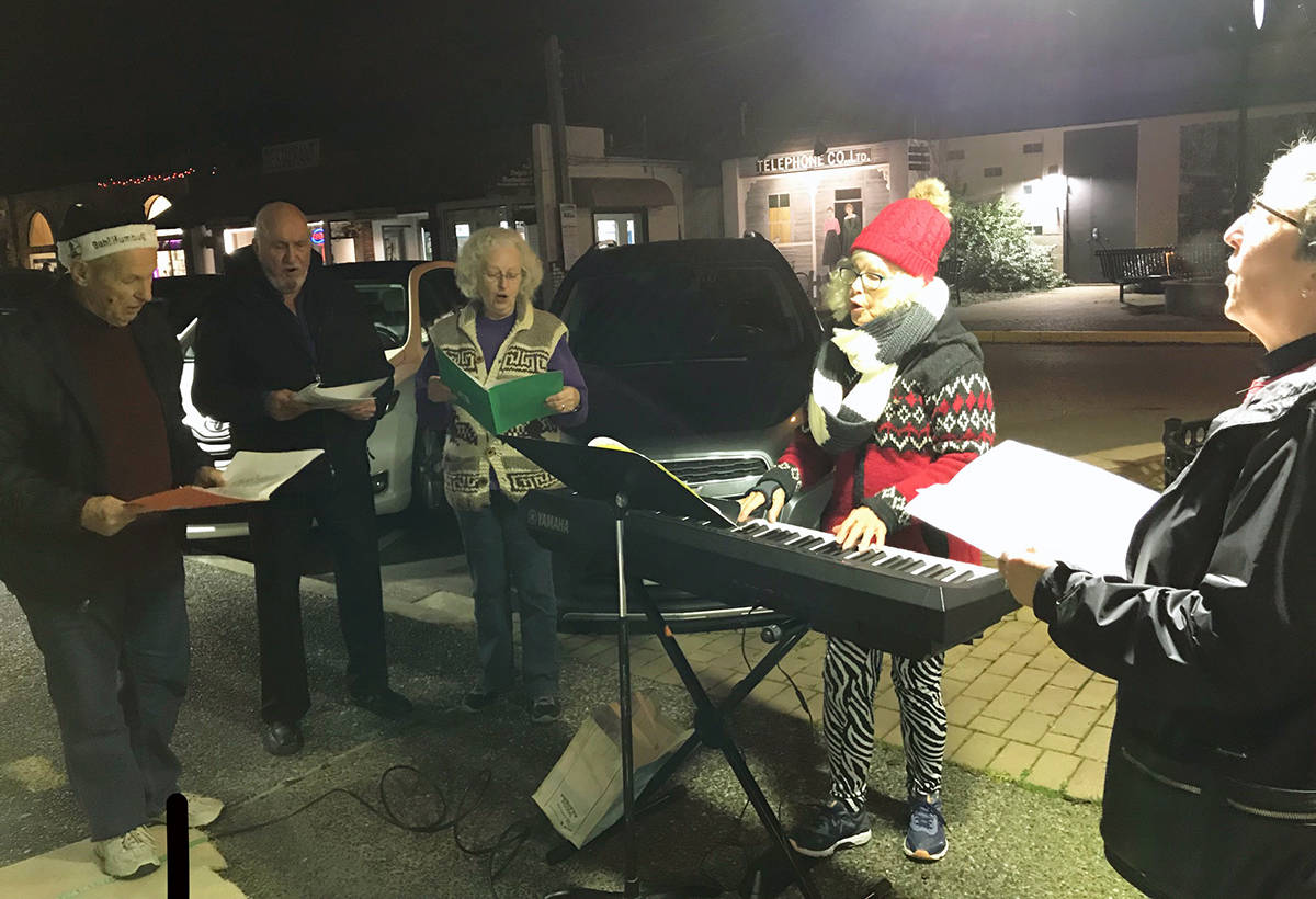 Wilma Rothbauer leads Chemainus United Church members in carolling on the streets. (Photo submitted)