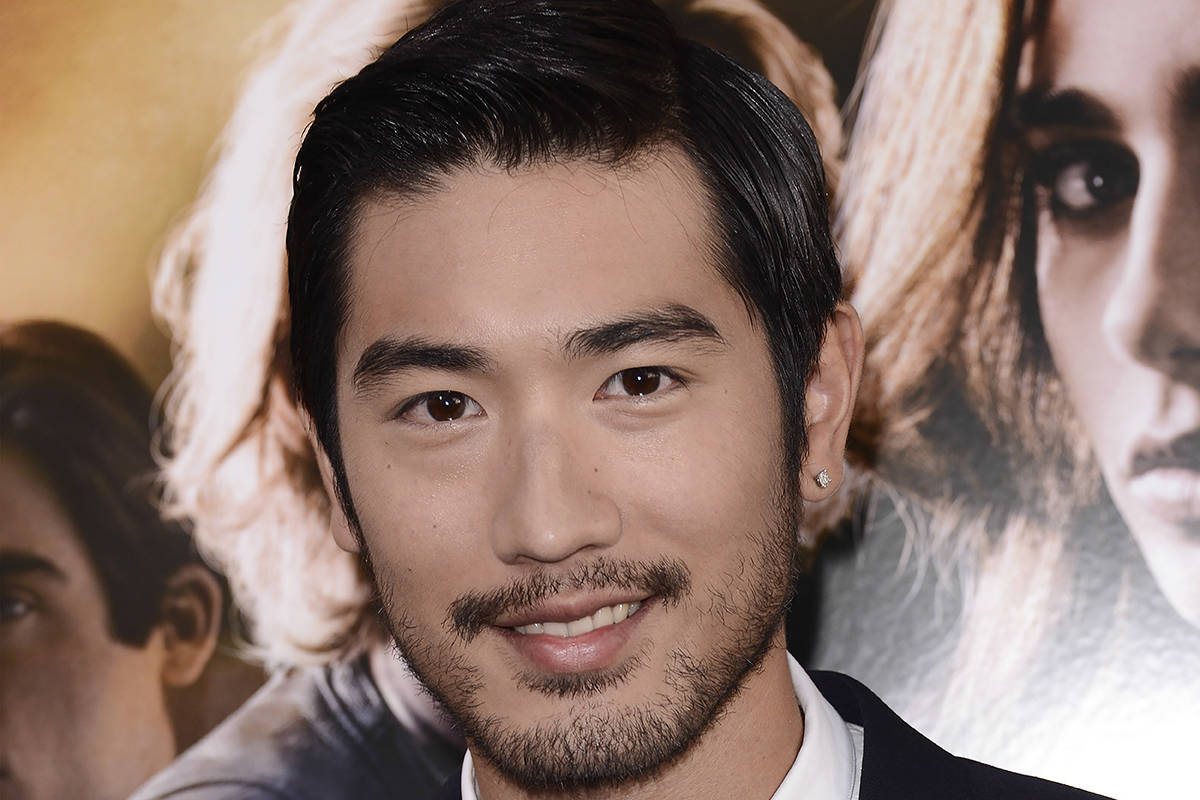 """FILE - In this August 12, 2013, file photo, actor Godfrey Gao arrives at the world premiere of """"The Mortal Instruments: City of Bones"""" at the ArcLight Cinerama Dome in Los Angeles. Gao has passed away while on set from an apparent heart attack. The 35-year-old Gao has passed away while on set from an apparent heart attack. Gao had been while filming a sports reality show in the eastern Chinese city of Ningbo on Wednesday when he died. His agency, JetStar Entertainment, confirmed his death on its official Facebook page. (Photo by Dan Steinberg/Invision/AP)"""