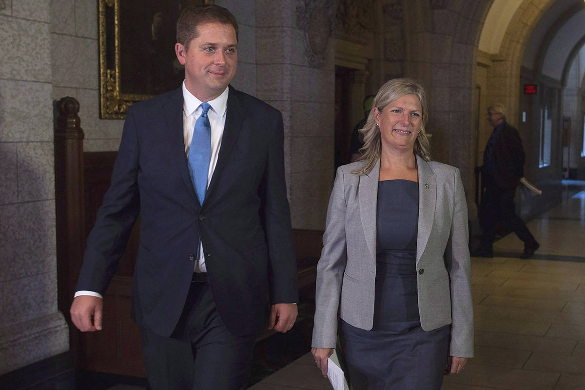 """Leader of the Opposition Andrew Scheer walks with Leona Alleslev, before Question Period on Parliament Hill in Ottawa, Monday, September 17, 2018. Andrew Scheer's second-in-command has apologized after comparing the Conservative leader's decision not to march in a Pride parade to choosing not to take part in a St. Patrick's Day parade. Leona Alleslev, who was named the Tories' deputy leader earlier this week, made the comments on an episode of the CBC News radio show """"The House"""" that aired this morning. THE CANADIAN PRESS/Adrian Wyld"""