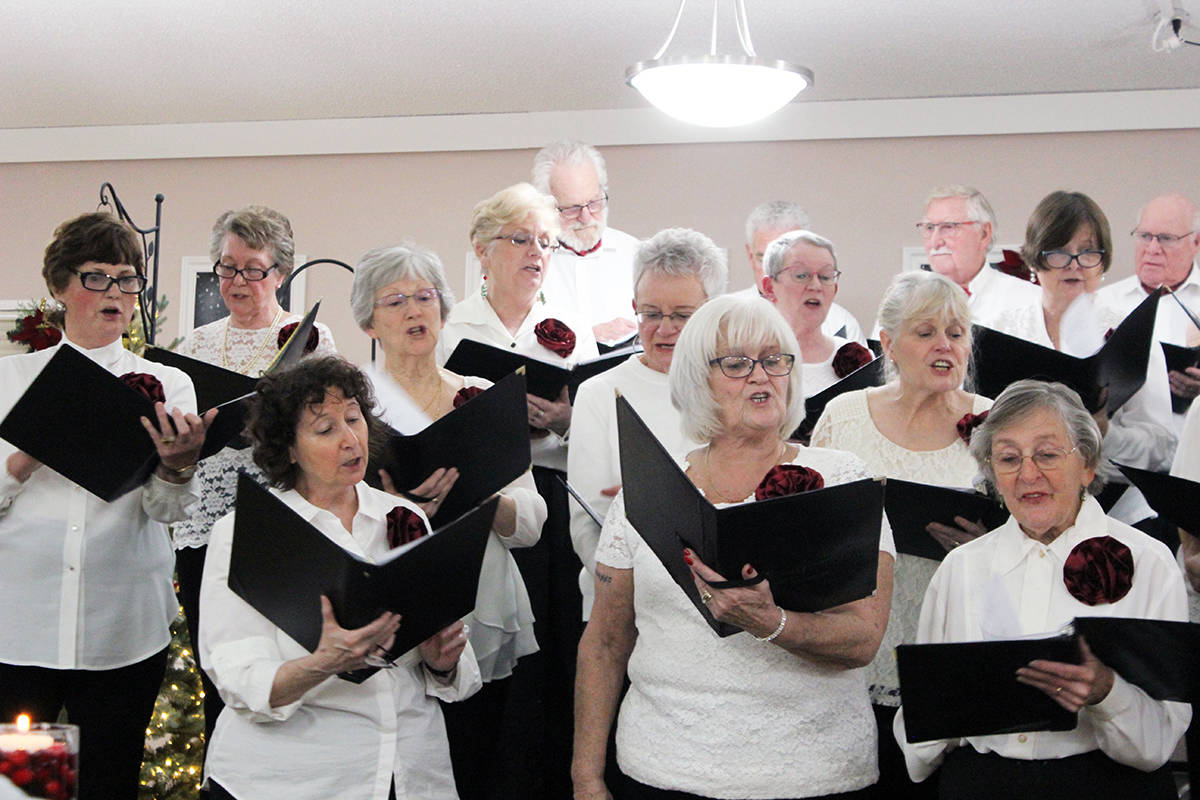 The Centre Belles women and the Centremen Songsters men join together for the grand finale of the after-dinner entertainment Saturday at the Chemainus 55+ Activity Centre. (Photo by Don Bodger)