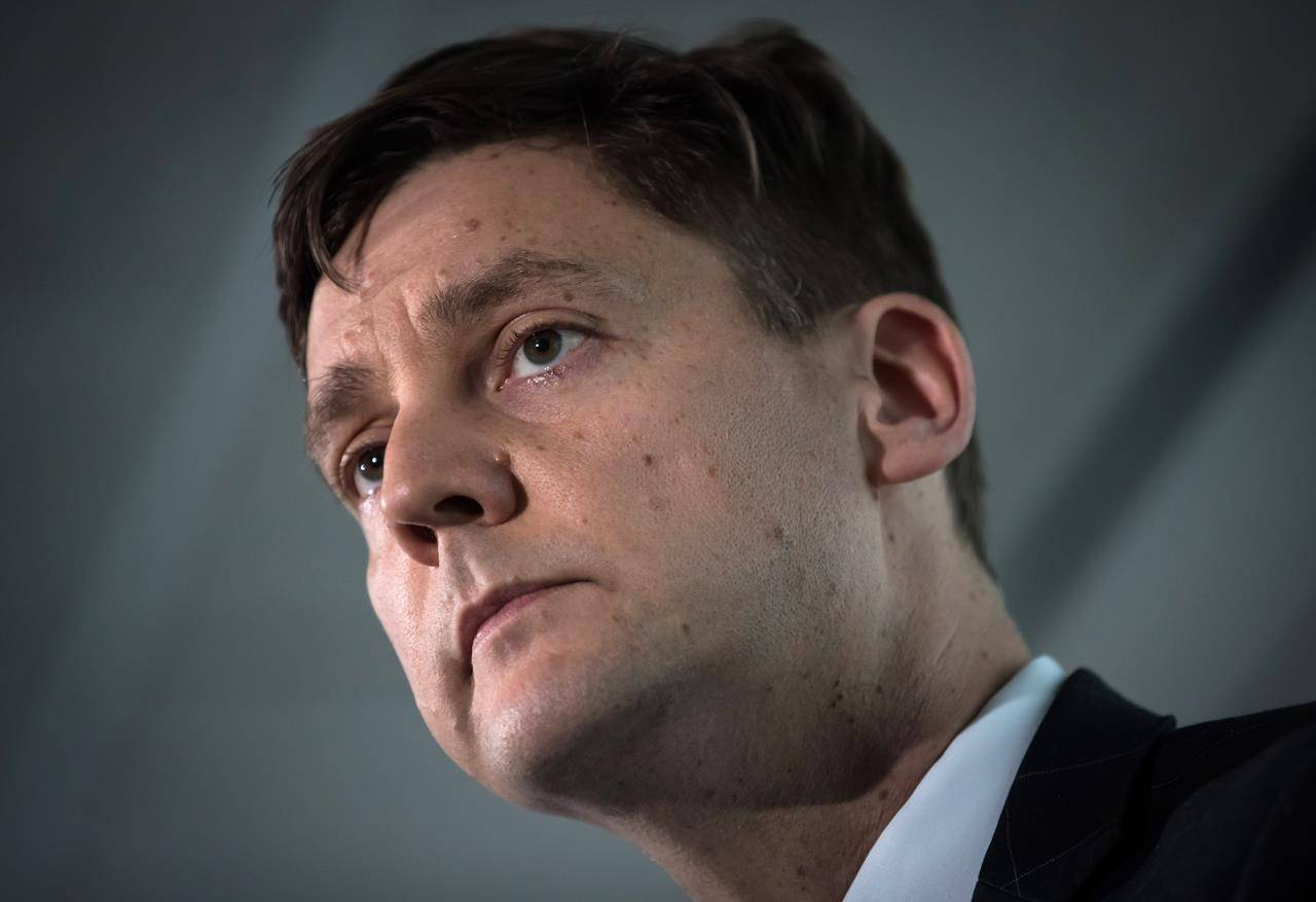 British Columbia Attorney General David Eby listens during a news conference in Vancouver, on Friday May 24, 2019. British Columbia's attorney general hopes an inquiry into money laundering will answer lingering questions about how the criminal activity flourished in the province and identify specific people who allowed it to happen. THE CANADIAN PRESS/Darryl Dyck