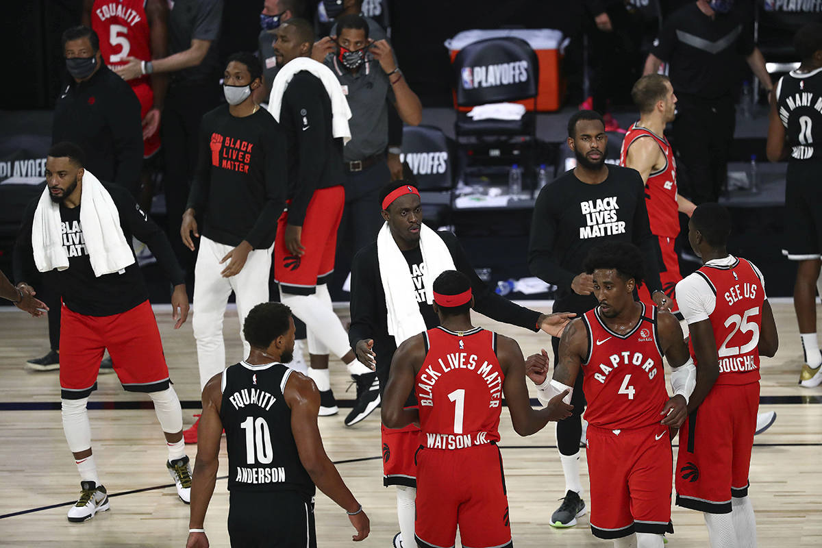 Toronto Raptors forward Pascal Siakam (43) and the Raptors celebrate the game and series victory against the Brooklyn Nets following Game 4 of an NBA basketball first-round playoff series, Sunday, Aug. 23, 2020, in Lake Buena Vista, Fla. THE CANADIAN PRESS/Kim Klement/Pool Photo via AP