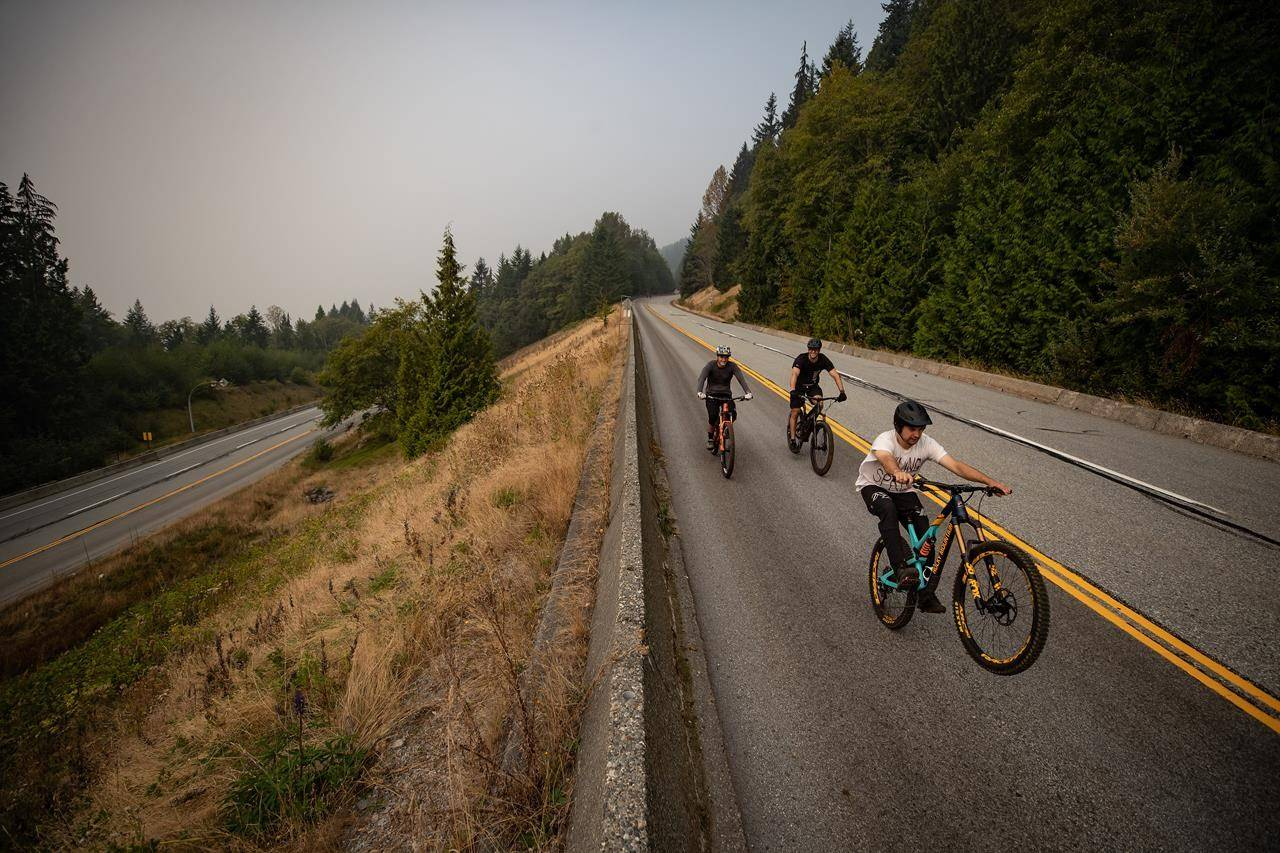 Smoke from wildfires burning in the U.S. fills the air as people ride bikes down the road at Cypress Provincial Park, in West Vancouver, B.C,, on Saturday, September 12, 2020. The World Air Quality Index, a non-profit that tracks air quality from monitoring stations around the world, rated Vancouver's air quality as the second worst in the world Saturday. Environment Canada has issued a special air quality statement for Metro Vancouver, showing a very high risk to health due to wildfire smoke from Washington and Oregon. THE CANADIAN PRESS/Darryl Dyck