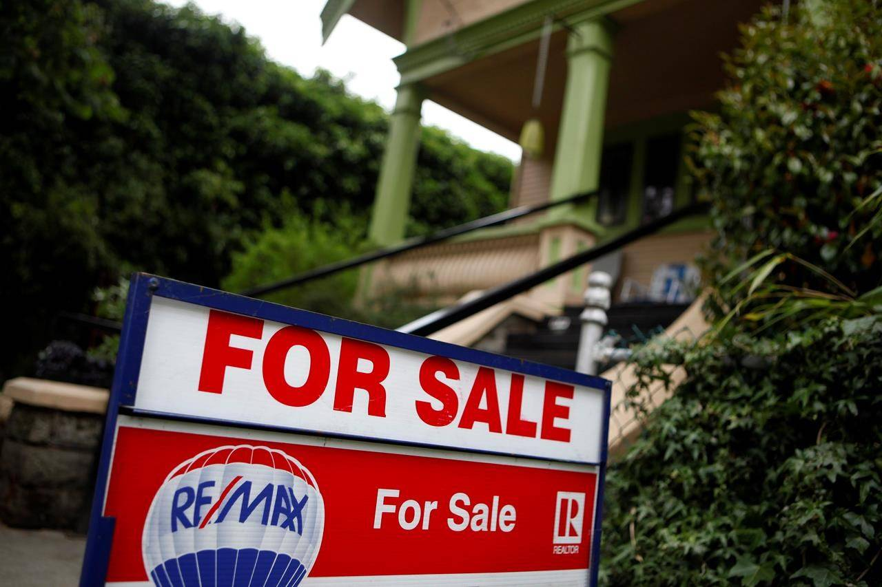 Investing in the busy real estate market of southern Vancouver Island and surrounding areas. New listings and sold signs can be seen around Victoria, B.C., on June 1, 2018. THE CANADIAN PRESS/Chad Hipolito