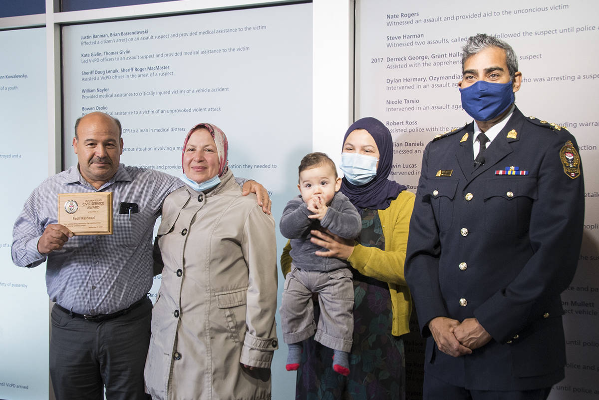 Taxi driver Fadil Rashead celebrated receiving the VicPD Civic Service Award with his wife Salam Rashead, daughter Hanadi Ponsford and eight-month-old grandson Musa. VicPD Chief Del Manak (far right) presented Fadil with the award after he helped police apprehend a dangerous sex offender. (Nina Grossman/News Staff)