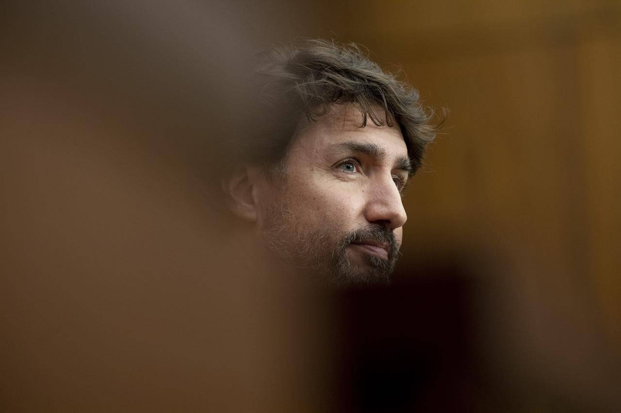 Prime Minister Justin Trudeau listens to a question during a news conference Monday, Oct. 5, 2020 in Ottawa. THE CANADIAN PRESS/Adrian Wyld