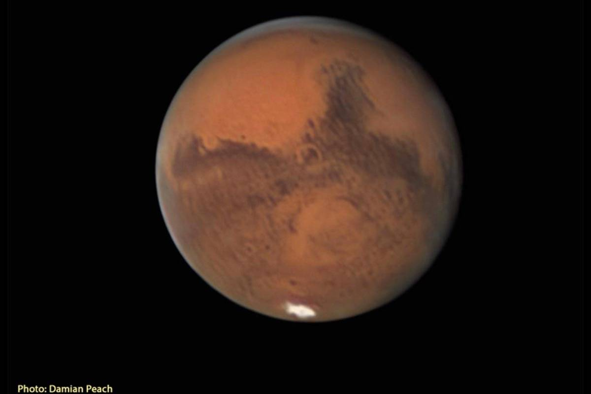 Mars will appear orange and distinct in the night sky this month. (Damian Peach photo)