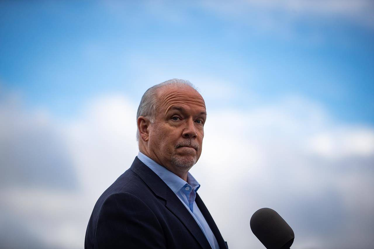 NDP Leader John Horgan pauses while responding to questions during a campaign stop, in Vancouver, on Monday, October 12, 2020. A provincial election will be held in British Columbia on October 24. THE CANADIAN PRESS/Darryl Dyck