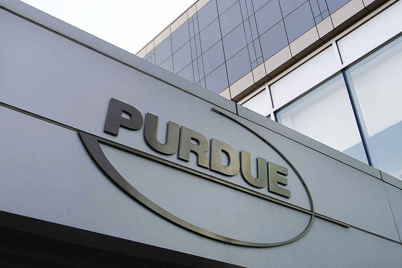 FILE - This Tuesday, May 8, 2007, file photo shows the Purdue Pharma logo at its offices in Stamford, Conn. Arizona's attorney general is asking the U.S. Supreme Court to force the Sackler family, which owns OxyContin-maker Purdue Pharma, to return billions of dollars they took out of the company. The court filing on Wednesday, July 31, 2019, marks the first time the high court has been asked to weigh in directly on the nation's opioid crisis. (AP Photo/Douglas Healey, File)