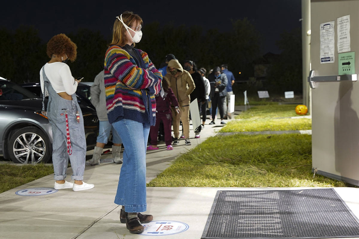 Aubrey Calaway, 23, waits to vote in the general election outside Victory Houston polling station in Houston on Friday, Oct. 30, 2020. The location was one of the Harris County's 24-hour locations. (Elizabeth Conley/Houston Chronicle via AP)