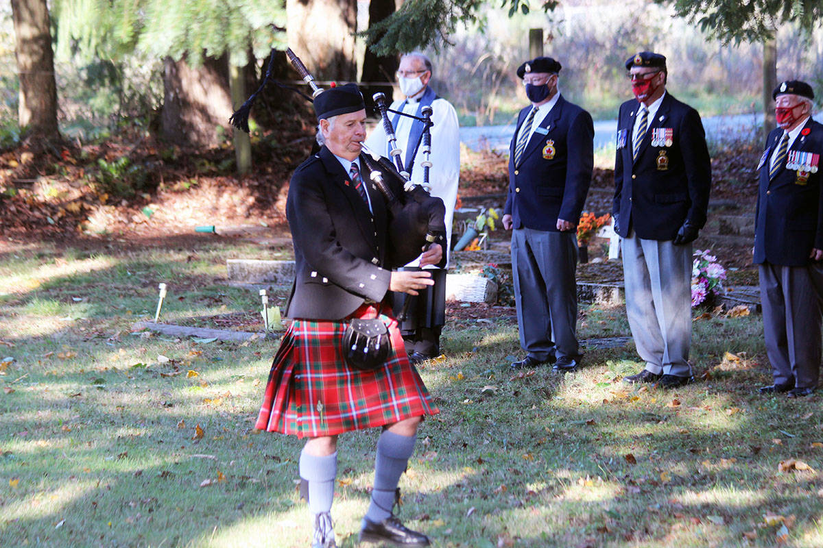 Piper Peter Leckie leads the way out of the Chemainus Cemetery following Sunday's service. (Photo by Don Bodger)