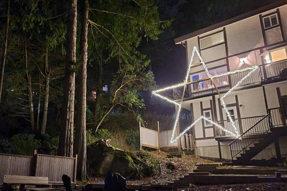 A giant star hoisted onto the back of a Colwood home can be seen from West Shore communities below. (Facebook/Leah Moreau)