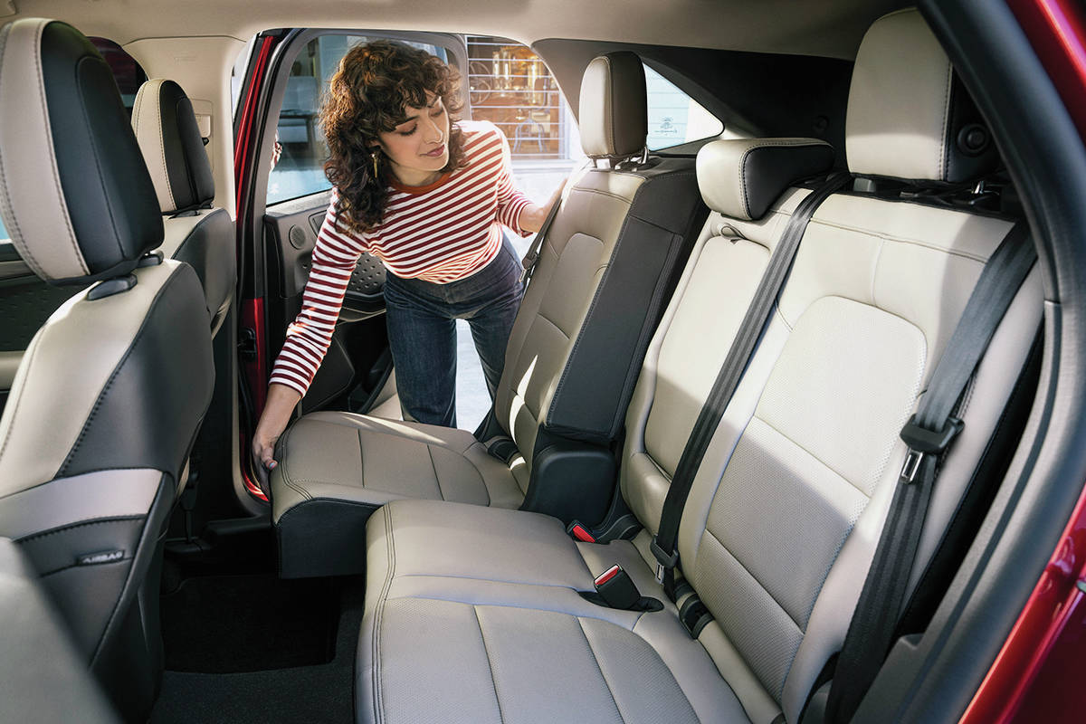 The only reason to move the rear seat forward — to give up leg room — is to make some extra space for cargo. This feature is not available with the hybrid models. PHOTO: FORD