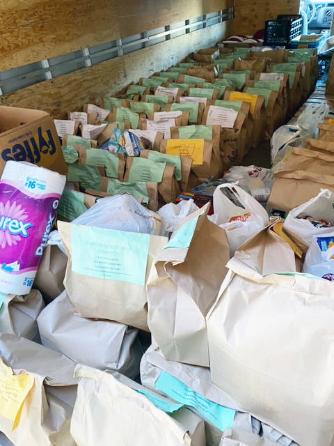 Bags of donated food for the Chemainus Harvest House Food Bank start to pile up in the Fill The Truck campaign. (Photo submitted)