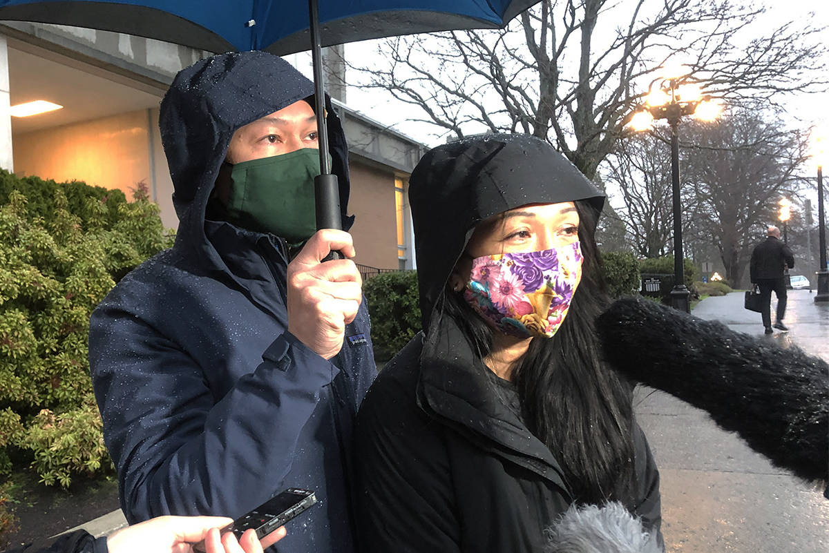 Tuan Bui and Kairry Nguyen, parents of Leila Bui, speak outside the courtroom after the woman who hit their daughter in a Saanich crosswalk in 2017 was sentenced to two years in prison. (Nina Grossman/News Staff)
