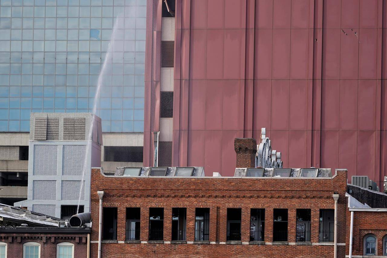Windows are blown out and a broken water pipe sprays in a building near the scene of an explosion in downtown Nashville, Tenn., Friday, Dec. 25, 2020. Buildings shook in the immediate area and beyond after a loud boom was heard early Christmas morning.(AP Photo/Mark Humphrey)