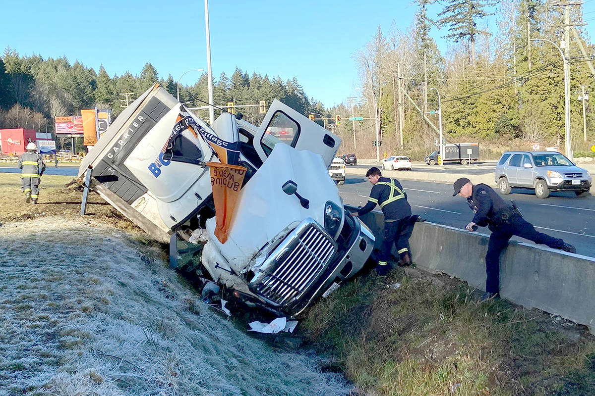 Emergency crews were called to a semi-truck crash along the Trans-Canada Highway at Oyster Sto'Lo Road on Friday, Jan. 22. (Cole Schisler/Black Press)