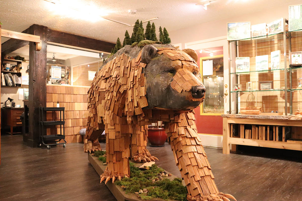 A large cedar sculpture of a bear occupies the centre of the gallery space. (Cole Schisler photo)