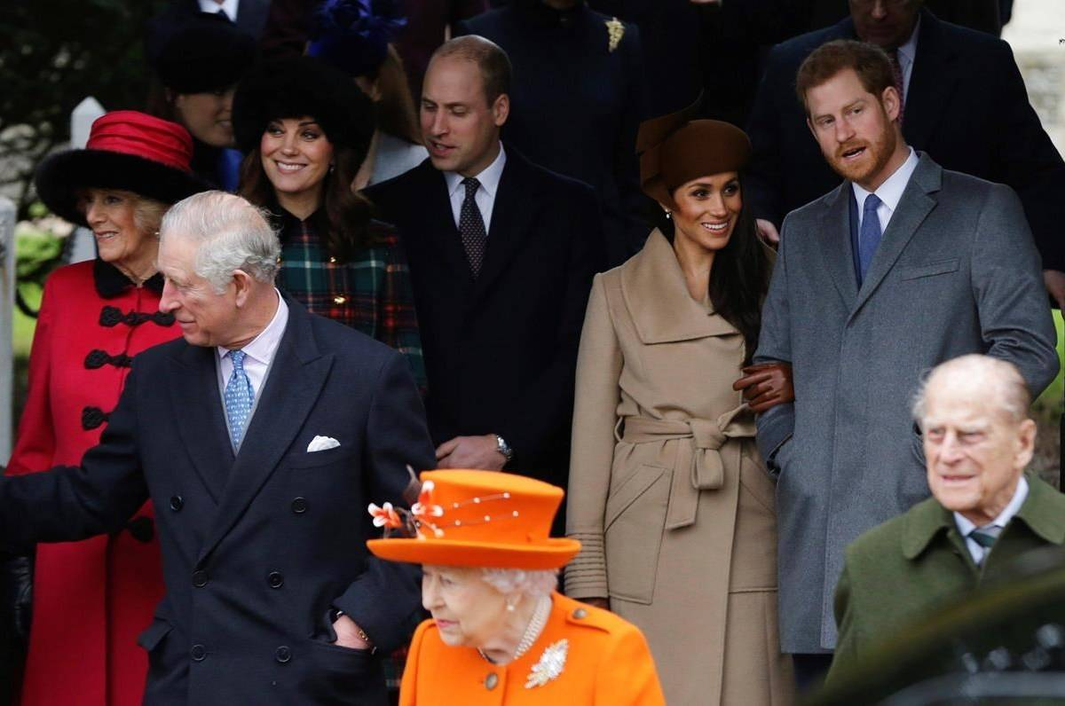 Britain's Prince Charles, front from left, Queen Elizabeth II and Prince Philip. Rear From left, Camilla, Duchess of Cornwall, Kate, Duchess of Cambridge, Prince William, Meghan Markle, and her fiancee Prince Harry, right, wait for the Queen to leave by car following the traditional Christmas Day church service, at St. Mary Magdalene Church in Sandringham, England, on December 25, 2017. A new poll suggests just over half of Canadians believe the British monarchy is a relic that Canada should dump, following Prince Harry and Meghan's interview with Oprah Winfrey. THE CANADIAN PRESS/AP, Alastair Grant