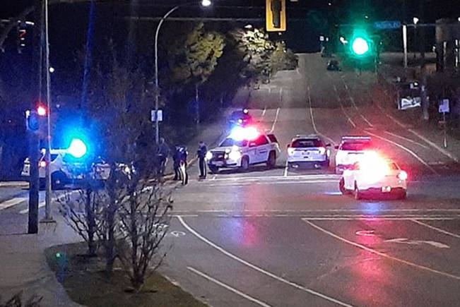 Police converge at the Dufferin Crescent and Boundary Avenue intersection in Nanaimo early Tuesday morning after a man allegedly left a taxi without paying fare and then bear-sprayed the taxi driver. (Photo submitted)