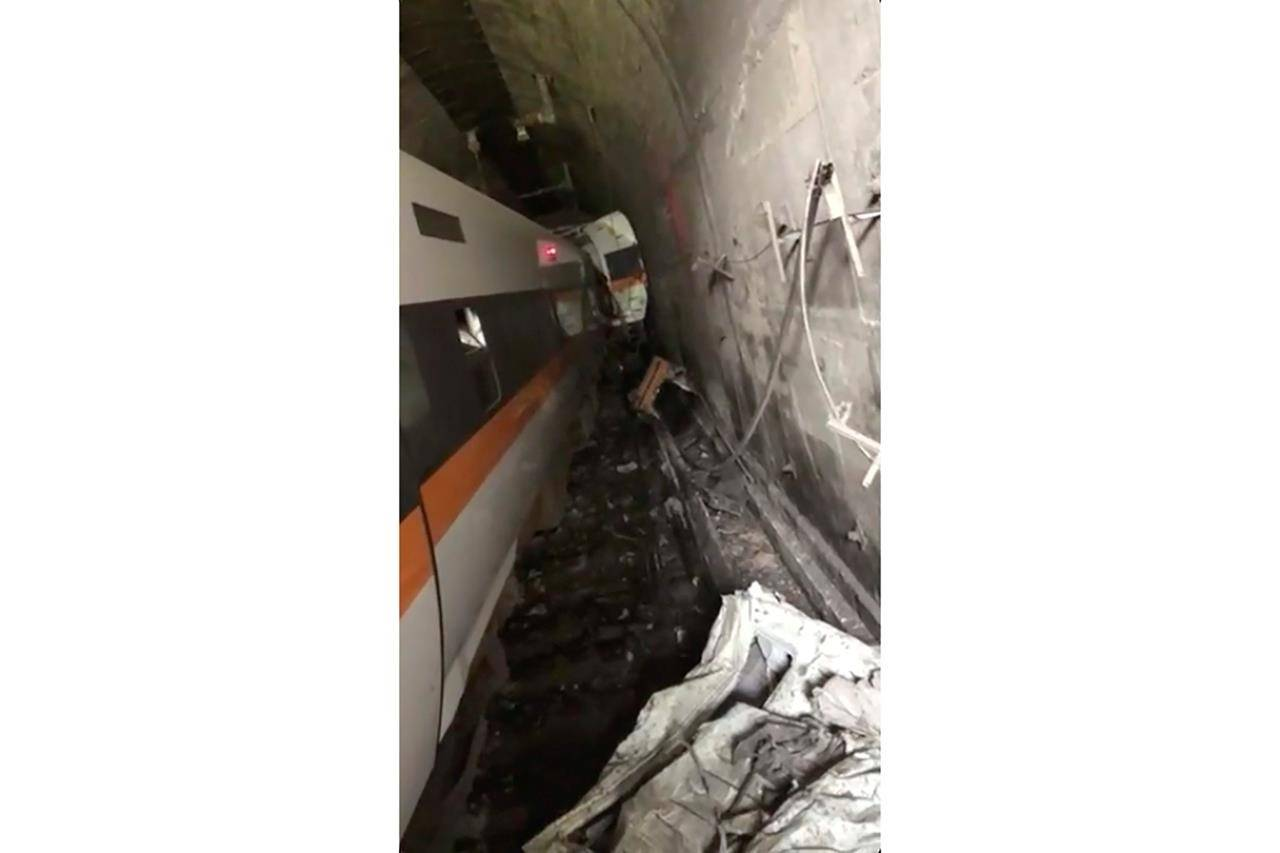 A train is stranded in a tunnel in Hualien County in eastern Taiwan Friday, April 2, 2021. The train partially derailed along Taiwan's east coast Friday, injuring an unknown number of passengers and causing potential fatalities. (Ministry of Interior, National Fire Department via AP)