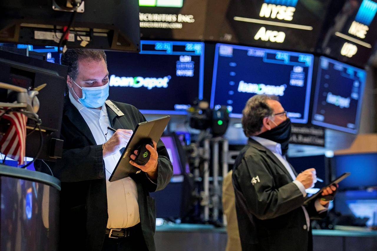 In this photo provided by the New York Stock Exchange, traders work on the floor, Monday Feb. 22, 2021. THE CANADIAN PRESS/AP-(Courtney Crow/New York Stock Exchange via AP