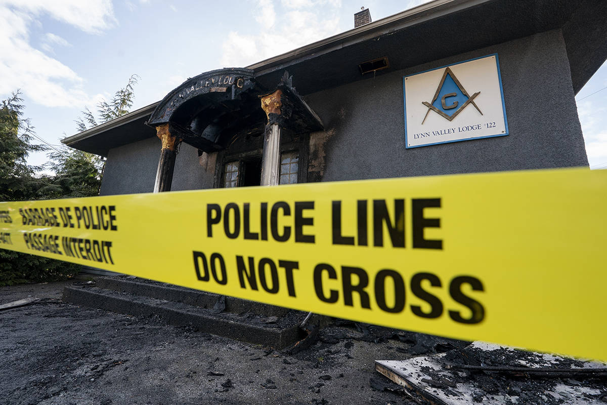 Police tape is seen outside a Masonic Temple in Lynn Valley in North Vancouver, B.C., Tuesday, March 30, 2021. A second Masonic Temple in the city of North Vancouver was later caught on fire, arson is being suspected. THE CANADIAN PRESS/Jonathan Hayward