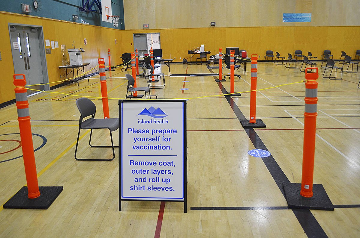 The inside of the Campbell River Community Centre gymnasium has been marked off in order to facilitate the public flowing through the clinic as they receive their COVID-19 vaccination. Photo by Alistair Taylor – Campbell river Mirror