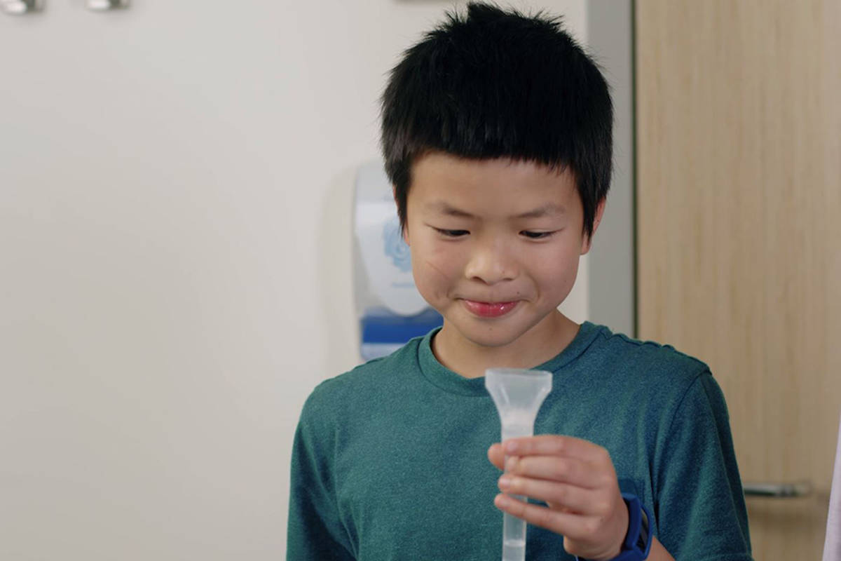A new saline gargle test, made in B.C., will soon be replacing COVID-19 nasal swab tests for kids. (PHSA screenshot)