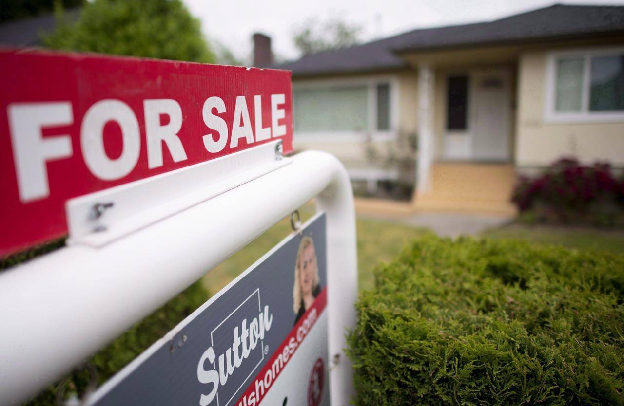 A real estate sign is pictured in Vancouver, B.C. THE CANADIAN PRESS Jonathan Hayward