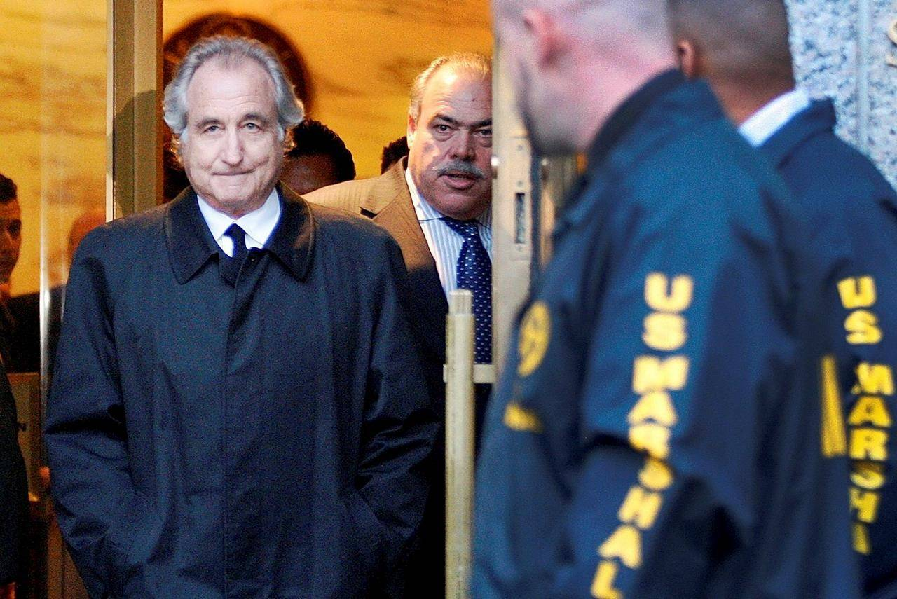 FILE - Disgraced financier Bernard Madoff leaves U.S. District Court in Manhattan after a bail hearing in New York, Monday, Jan. 5, 2009. Madoff, the financier who pleaded guilty to orchestrating the largest Ponzi scheme in history, died early Wednesday, April 14, 2021, in a federal prison, a person familiar with the matter told The Associated Press. (AP Photo/Kathy Willens, File)