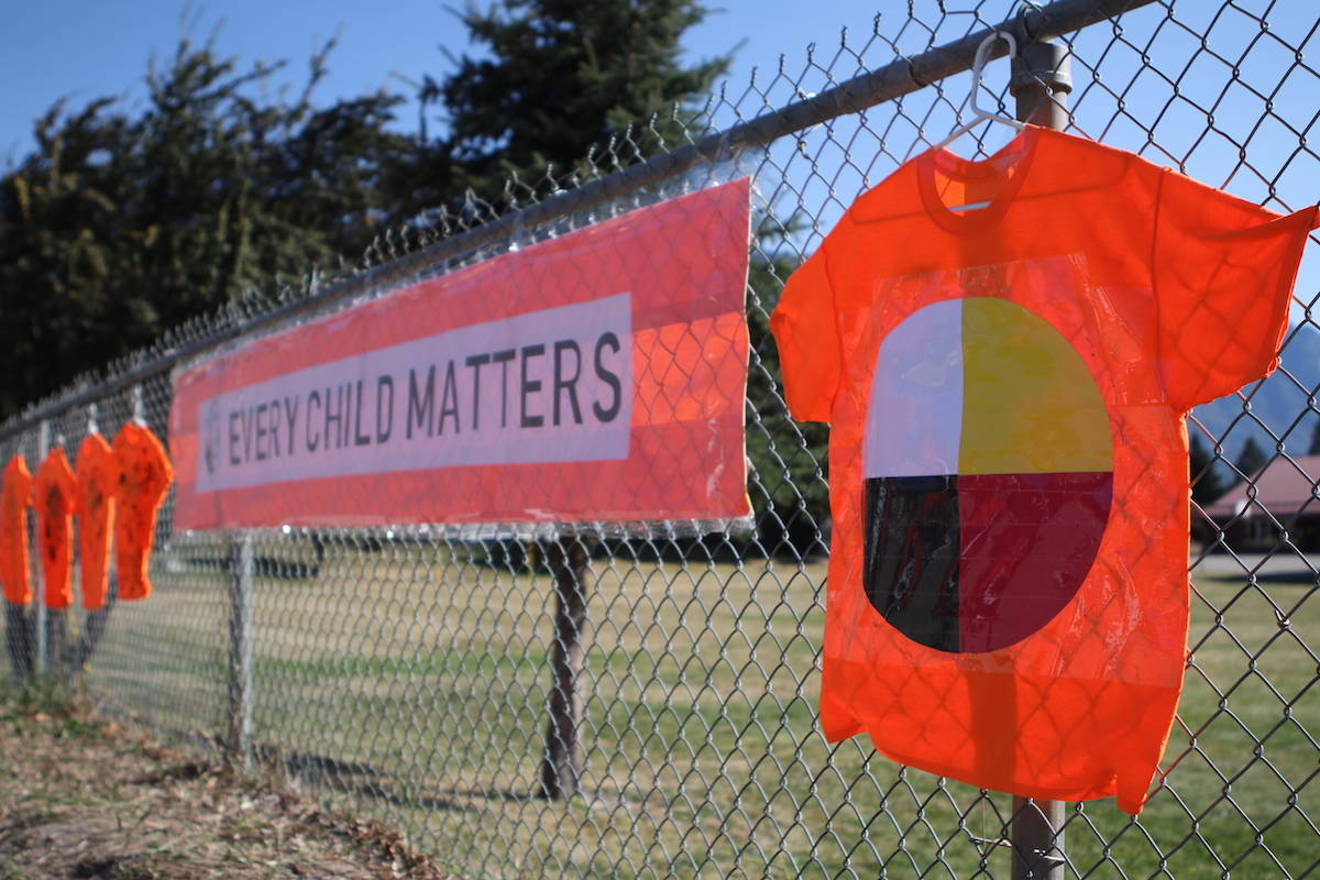 FILE – The fence of Erickson Elementary School was lined with 22 orange shirts on Sept. 30 in honour of Orange Shirt Day. (Aaron Hemens - Creston Valley Advance)