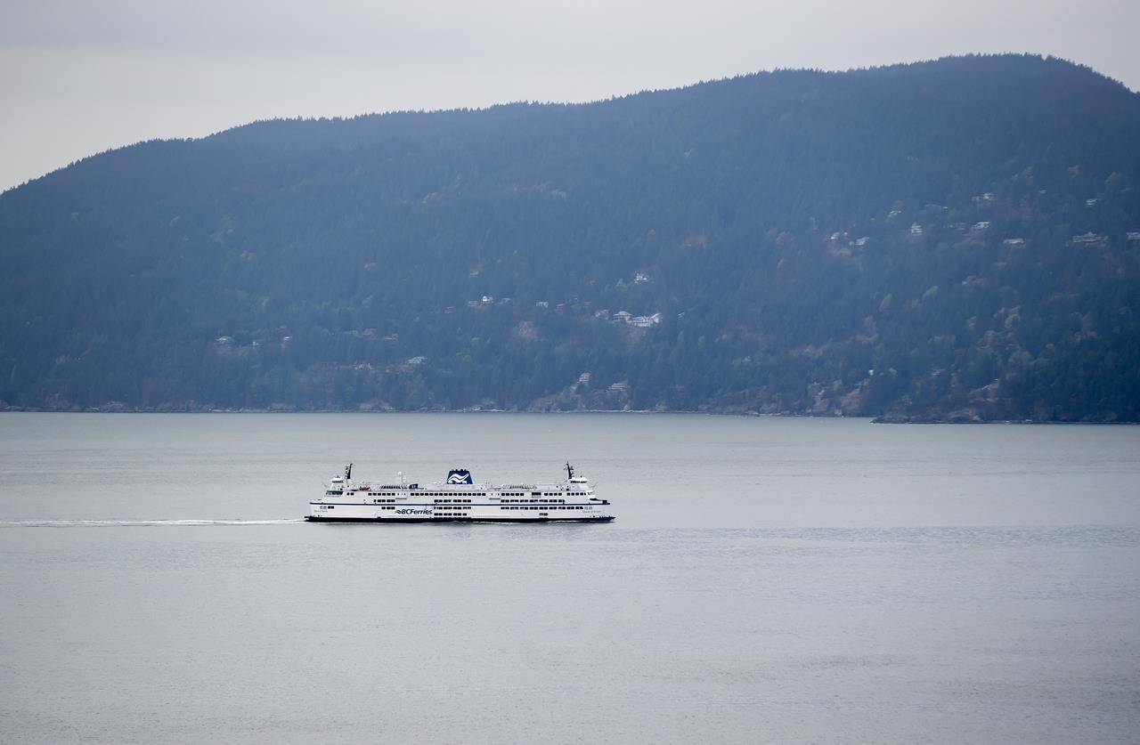 FILE – A B.C. Ferries vessel passes Bowen Island while traveling on Howe Sound from Horseshoe Bay to Langdale, B.C., on Friday, April 23, 2021. A BC Ferries passenger was recovered from the waters near Bowen Island after going overboard Sunday, after another passenger witnessed them fall off the ferry mid-afternoon. THE CANADIAN PRESS/Darryl Dyck