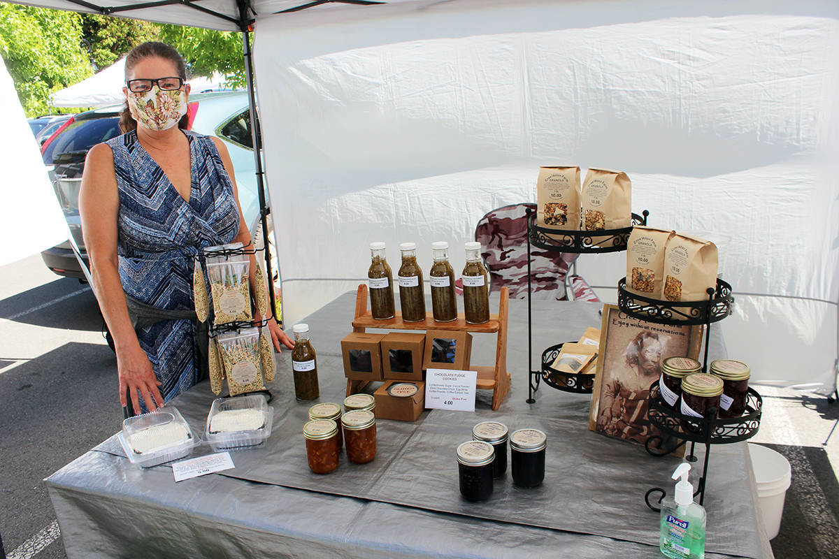 Kim Agla of Cree'Ation Farm on Oak Street with the products at her stall. (Photo by Don Bodger)