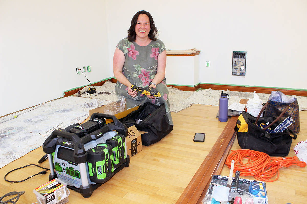 Amy Hughes pulls out some power tools and other equipment to work on the interior of the new location for her Bound To Be Different shop. (Photo by Don Bodger)