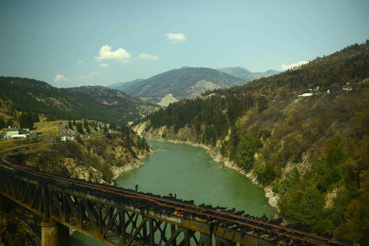A railway bridge is seen burnt in Lytton, B.C. on Friday, July 9, 2021, nine days after a wildfire ripped through the village on June 30, 2021. (Jenna Hauck/ Black Press Media)