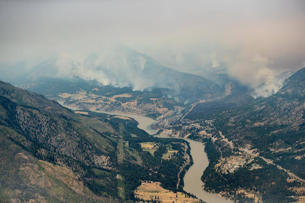 A wildfire burns in the mountains north of Lytton, B.C., on Thursday, July 1, 2021. THE CANADIAN PRESS/Darryl Dyck
