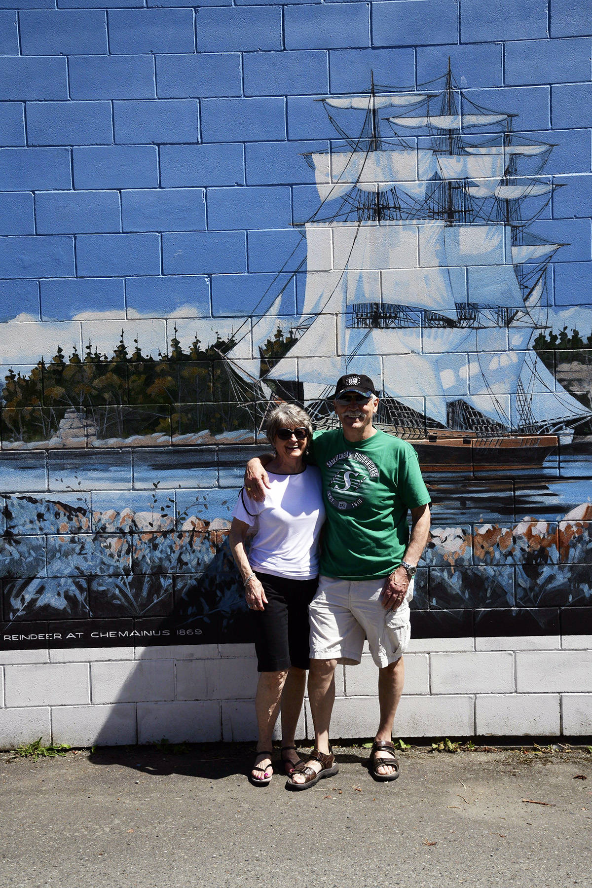 Doreen and Ray Zielke at the HMCS Reindeer mural. (Photo submitted)