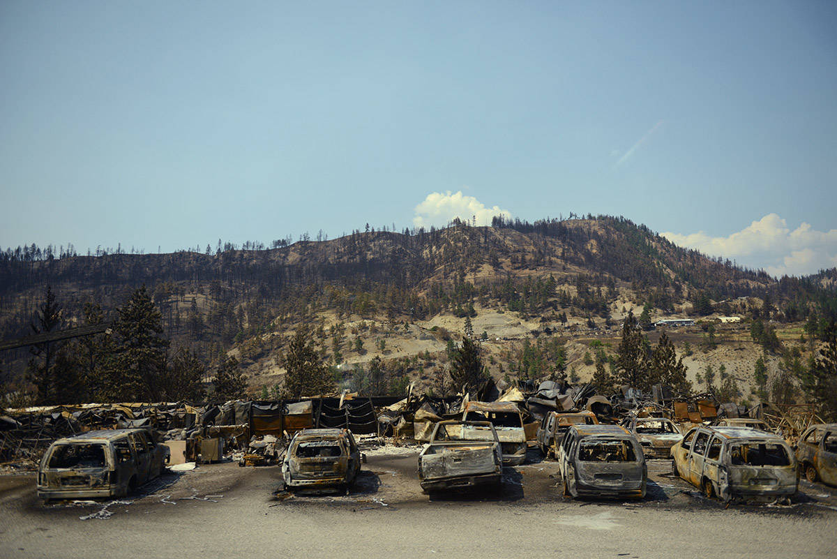 A row of burnt cars parked along Highway 1, just outside the Village of Lytton, B.C. on Friday, July 9, 2021 following a massive wildfire that tore through the town destroying 90 per cent of it. (Jenna Hauck/ Black Press Media)