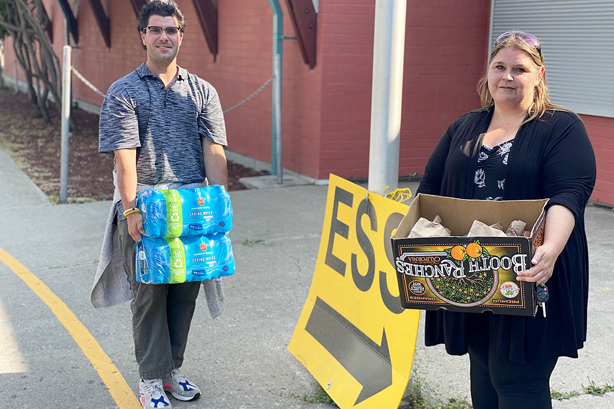Chris Cardamone and Jen Wiggins of the Southern Dakelh Nation Alliance deliver water and bagged lunches to the ESS centre in Williams Lake Wednesday afternoon (July 14). The food was for Ulkatcho First Nation evacuees who were flown out of their community west of Williams Lake.(Angie Mindus photo - Williams Lake Tribune)