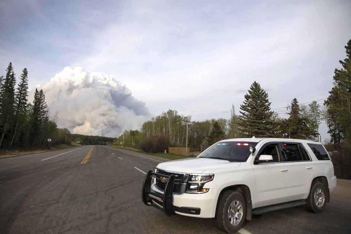 A plume of smoke rise from a forest fire burning northeast of the city in Prince Albert, Sask., Monday, May 17, 2021. (The Canadian Press/Kayle Neis) A plume of smoke rise from a forest fire burning northeast of the city in Prince Albert, Sask., Monday, May 17, 2021. (The Canadian Press/Kayle Neis)