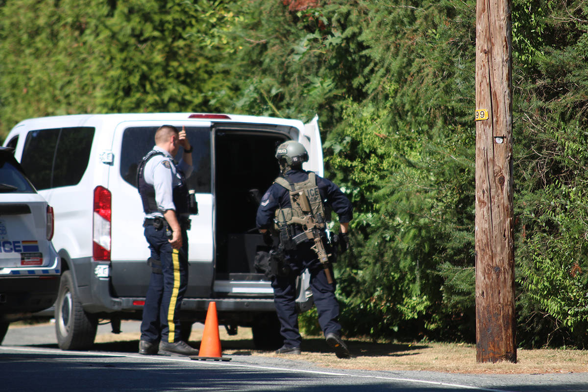 RCMP officers have blocked off a section of Bell McKinnon Road north of Duncan Wednesday afternoon, Aug. 4, 2021. (Kevin Rothbauer/Citizen)