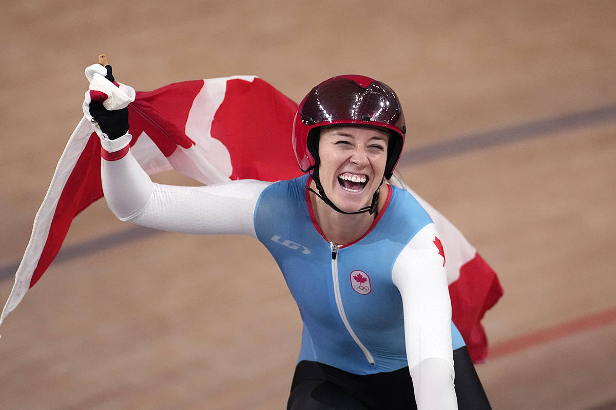 Kelsey Mitchell of Team Canada reacts after winning the gold medal during the track cycling women's sprint race at the 2020 Summer Olympics, Sunday, Aug. 8, 2021, in Izu, Japan. (AP Photo/Christophe Ena)