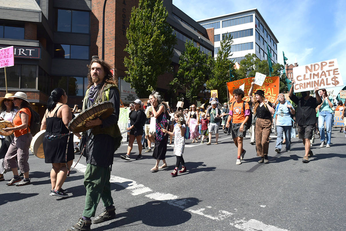 Protesters calling for the end of old-growth logging marched to the B.C. Legislature on Monday, Aug. 9. (Don Denton/Black Press Media)