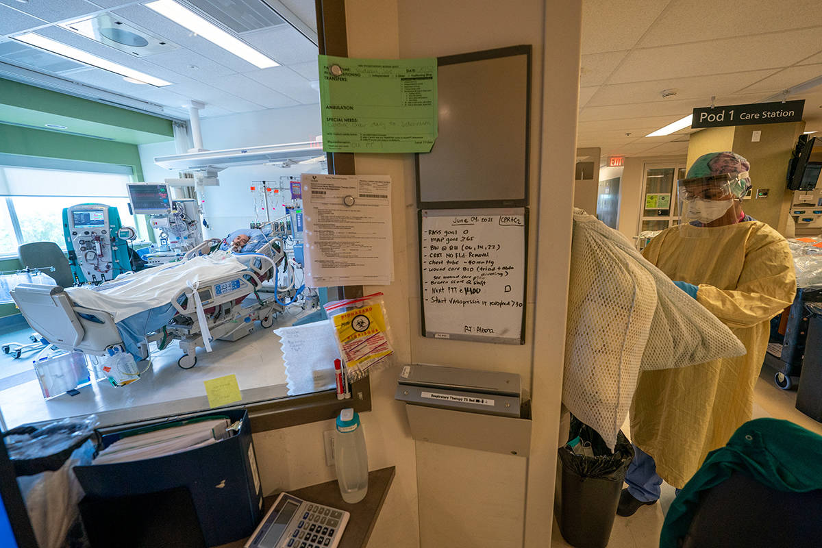 FILE – Registered Nurse Manjot Kaur Munday, prepares with her PPE prior to visiting a COVID-19 patient at the COVID-19 Intensive Care Unit at Surrey Memorial Hospital in Surrey, B.C., Friday, June 4, 2021. THE CANADIAN PRESS/Jonathan Hayward