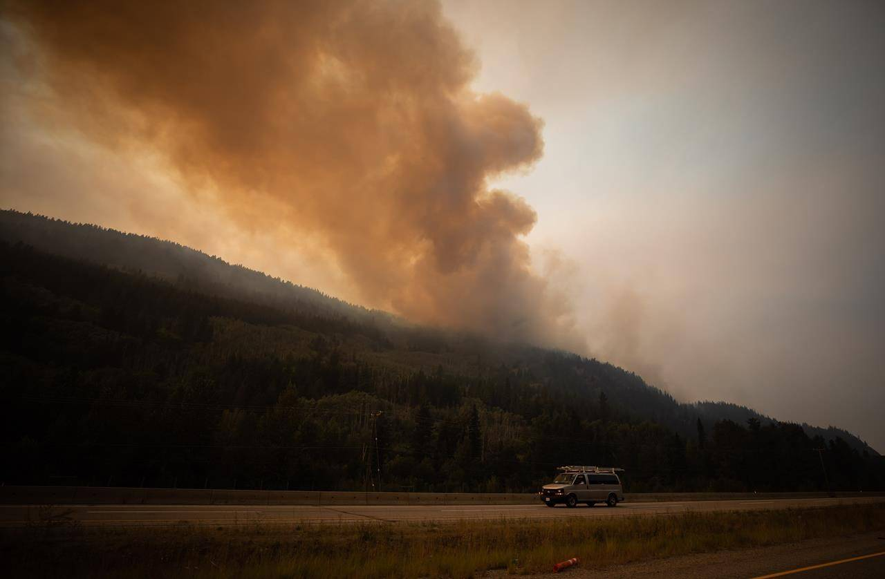 The July Mountain wildfire burns along the Coquihalla Highway south of Merritt, B.C., on Wednesday, August 11, 2021. THE CANADIAN PRESS/Darryl Dyck
