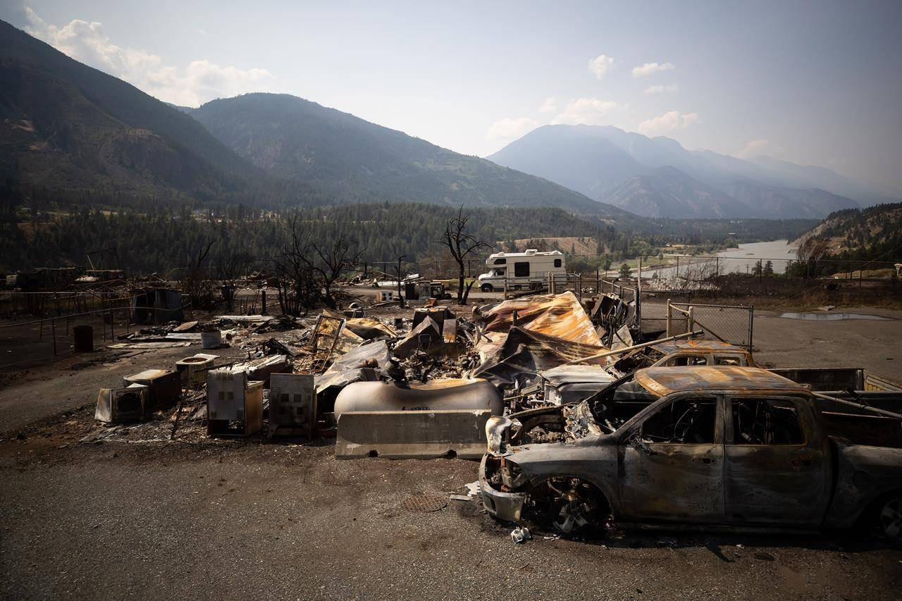 Damaged vehicles and a structure is seen in Lytton, B.C., Friday, July 9, 2021, after a wildfire destroyed most of the village on June 30. The estimated $78 million in insured property damage from the wildfire that devastated the community of Lytton, B.C., in June is a fraction of the rising costs of disasters fuelled by climate change, the Insurance Bureau of Canada says. THE CANADIAN PRESS/Darryl Dyck
